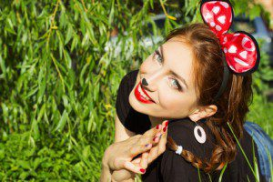 beautiful girl happy smiling in the costume of a mouse